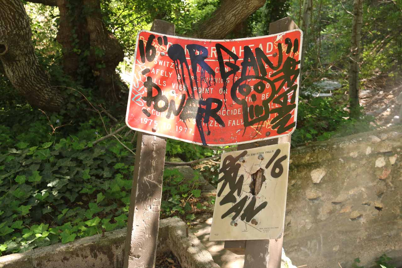 Finally to satisfy my curiosity about the trail to the left of the junction by the old stoves, I decided to check out what was at its end, and along the way, I encountered this graffiti-laced sign