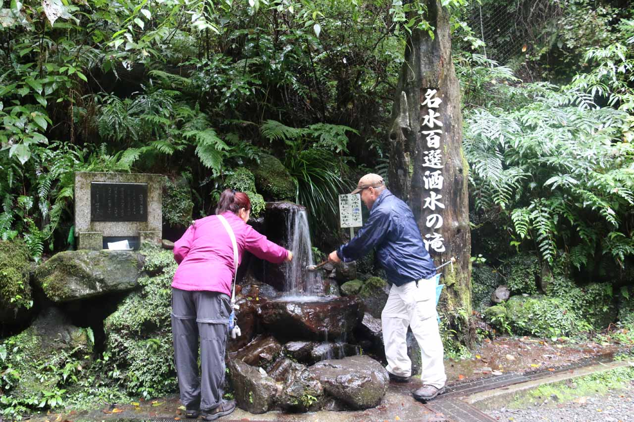 Mom and Dad willing to taste the water from this fountain, which Mom described as having a 'sweet' taste. Could this be why the name of Syasui Falls could be translated to mean 'Wine Falls'
