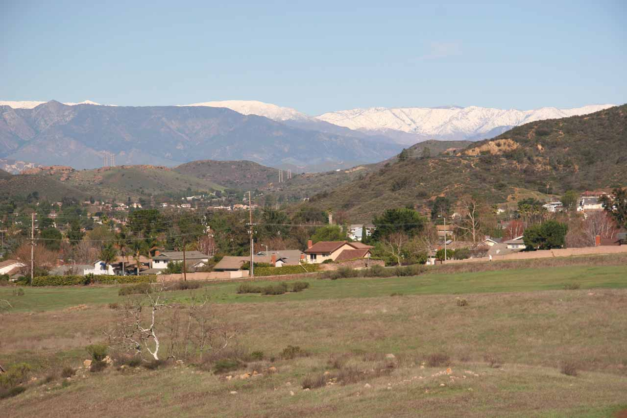 Looking back at homes and snow on mountains