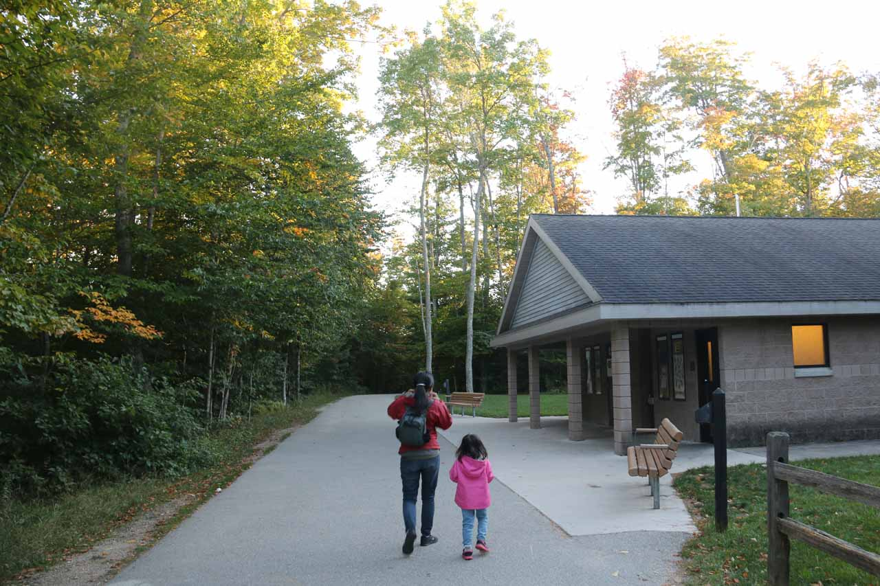 Julie and Tahia going past the restroom facilities onto the well-developed path to the Upper Tahquamenon Falls