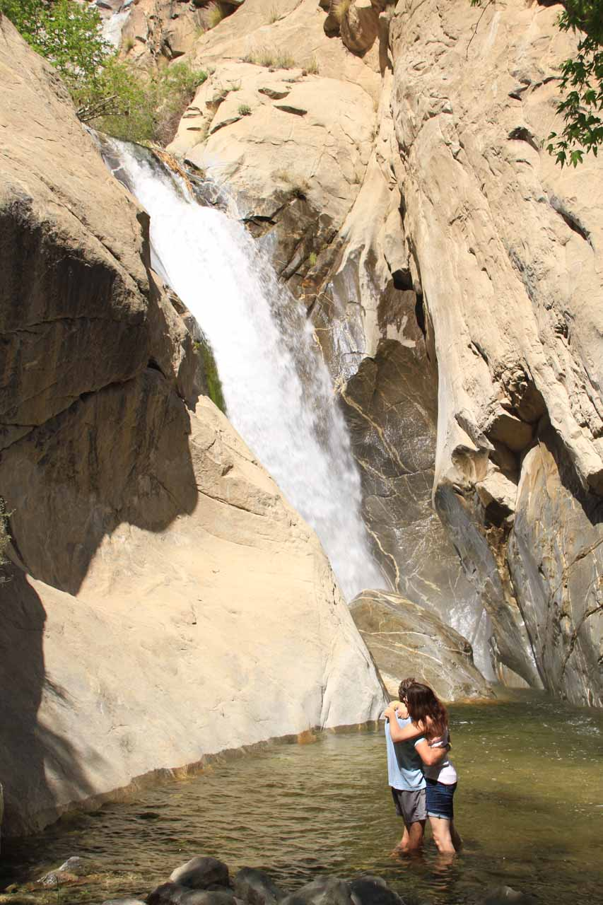 Couple embracing each other before the falls