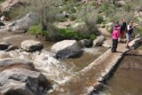 Tahquitz_Falls_017_02252017 - Mom crossing Tahquitz Creek over this bridge that looked like it might have seen some flooded conditions in February 2017