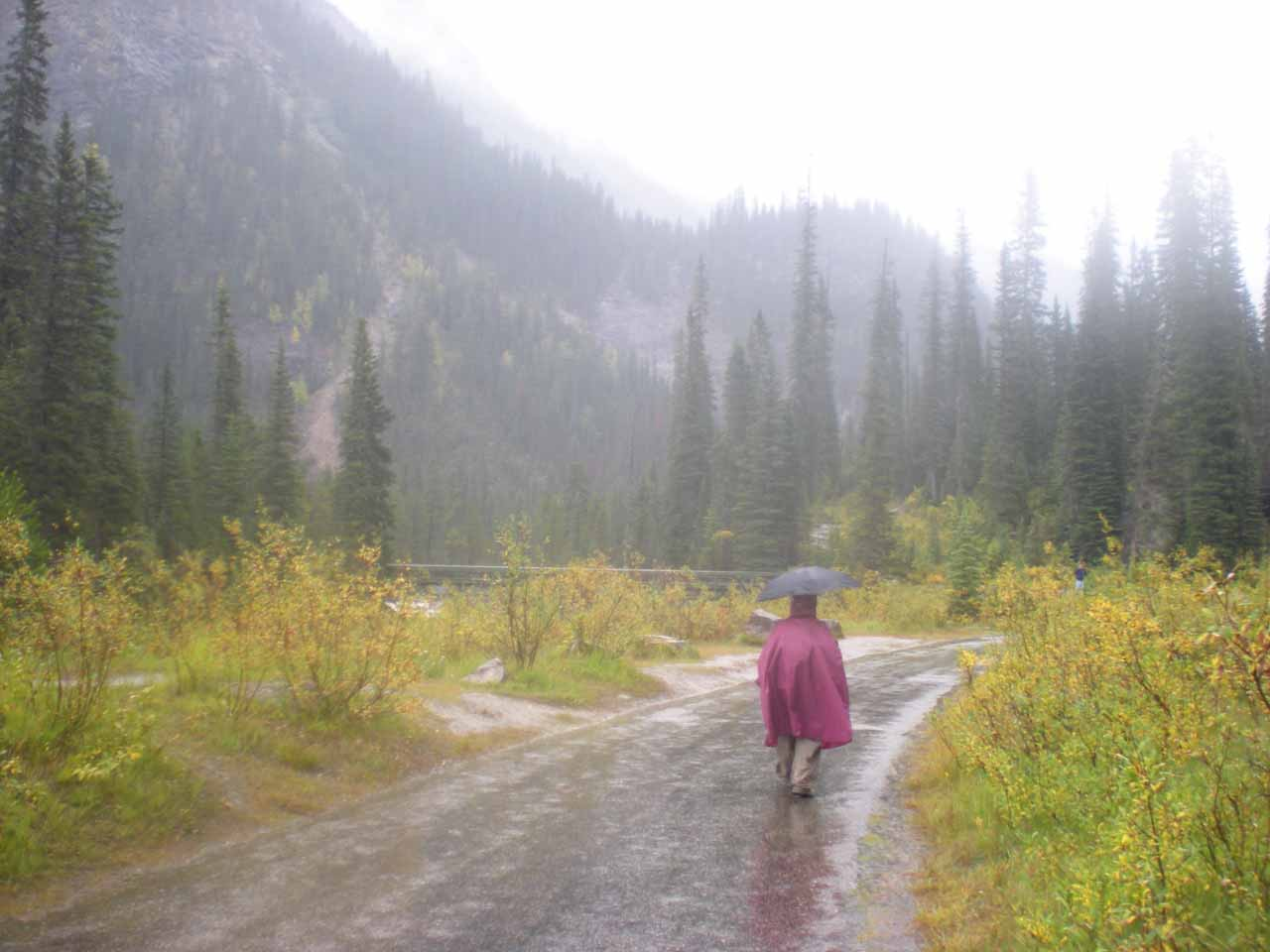 Julie on the wet and rainy walkway to Takakkaw Falls