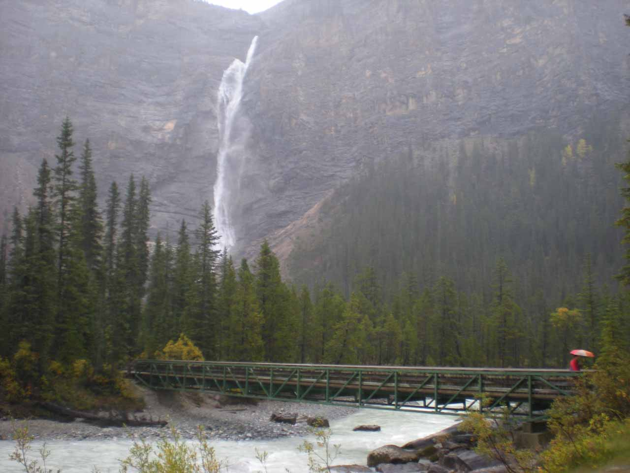 Julie crossing the bridge over the Yoho River before the Takakkaw Falls