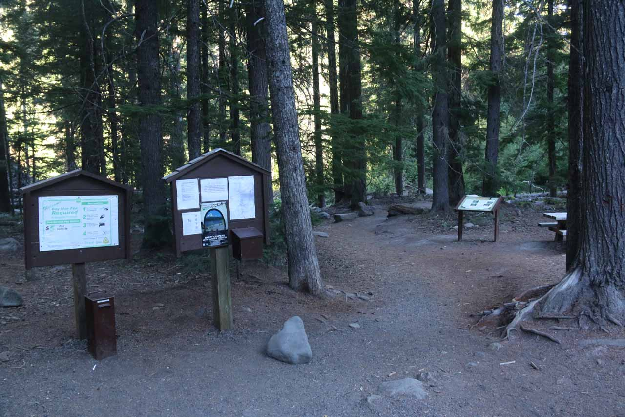 Some signage and picnic tables at the trailhead