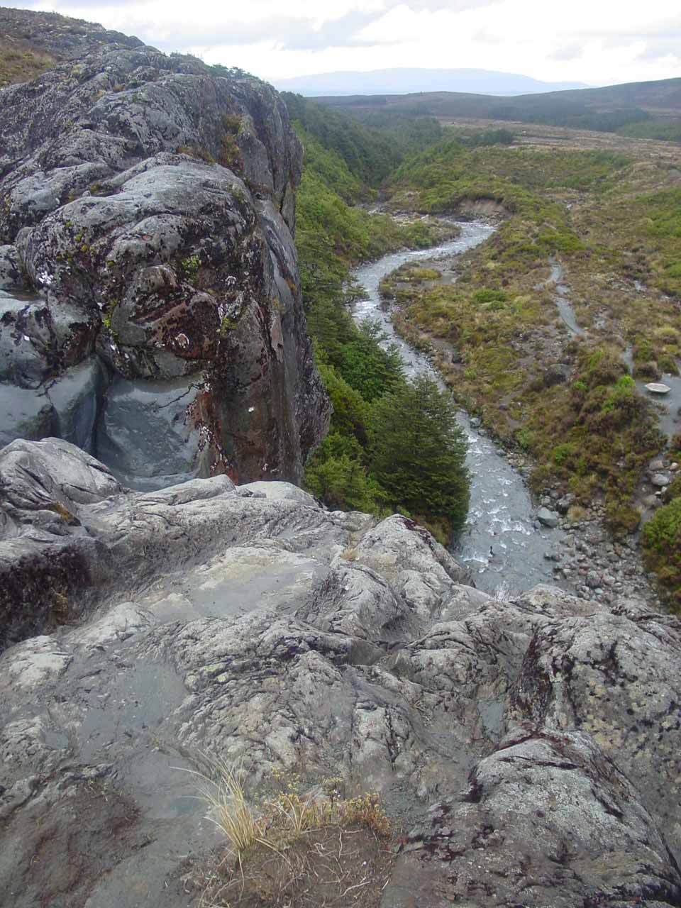 Looking over the top of Taranaki Falls towards the meandering Wairere Stream making its way along the fringes of bush on one side and open terrain on the other