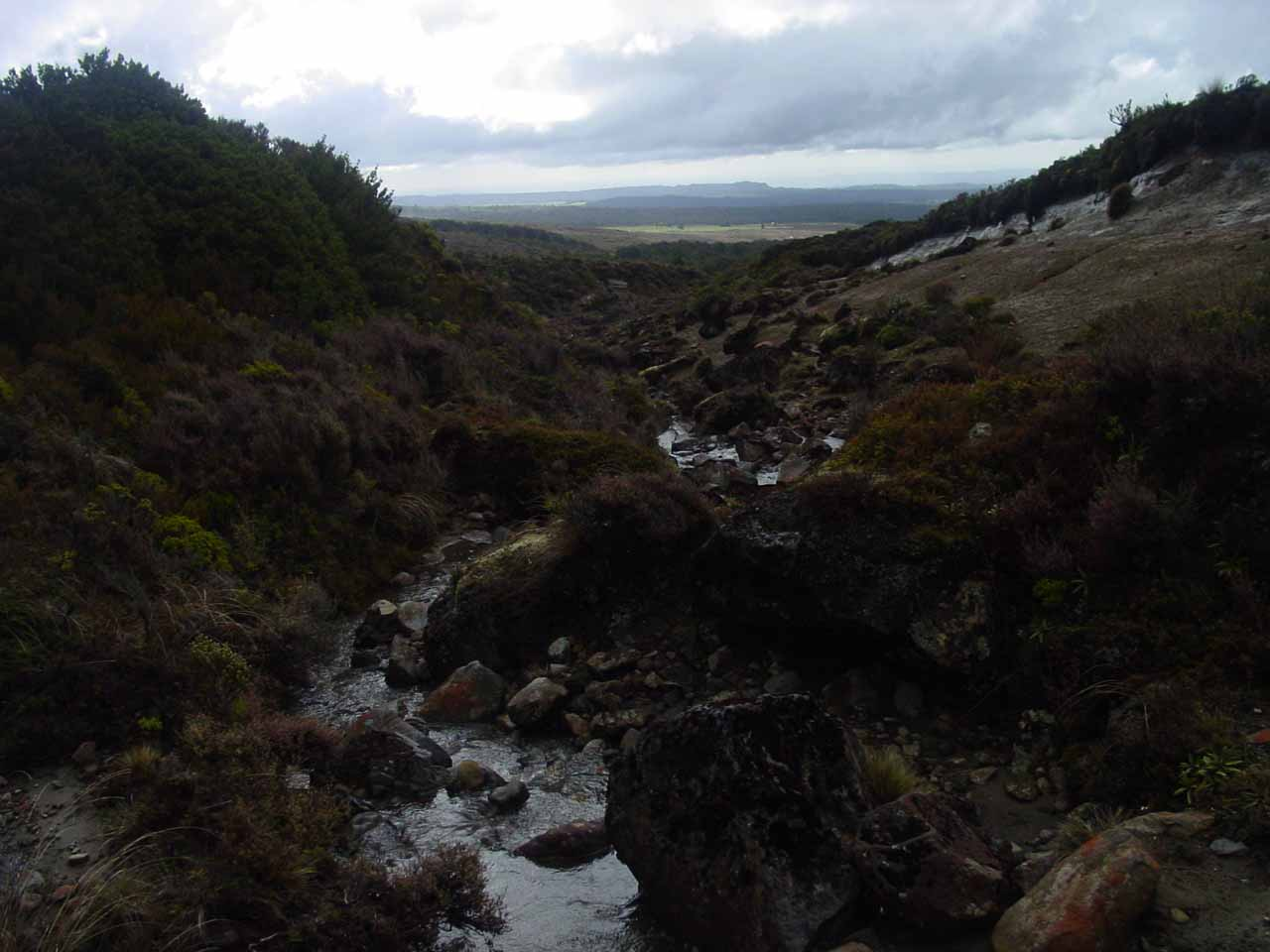 Looking downstream along some small ephemeral stream towards the open terrain further downslope of the Tongariro Northern Circuit