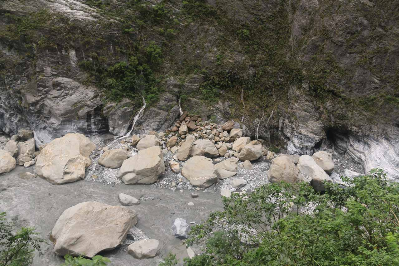 Several smaller springs emerging from the base of the Taroko Gorge cliffs in parallel