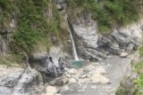 Taroko_Gorge_140_10262016 - Looking down at one of the natural waterfalls spilling into a clearwater plunge pool while flanked by springs emerging from the marble cliffs of the Taroko Gorge near the Swallow Grotto