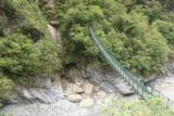 Taroko_Gorge_205_10262016 - Looking across a swinging bridge traversing the Taroko Gorge perhaps allowing people to visit a different section of the Swallow Grotto from the other side of the river
