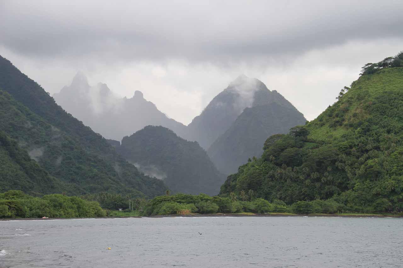 The mountains rising sharply behind the Vaitepiha River Valley