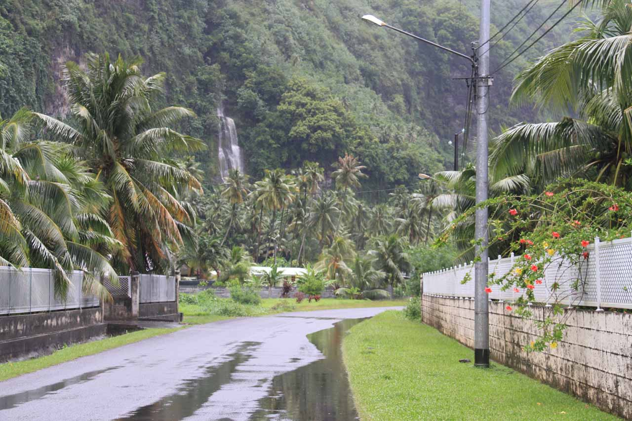 Driving the main Taravao-Tautira road with a waterfall in the distance