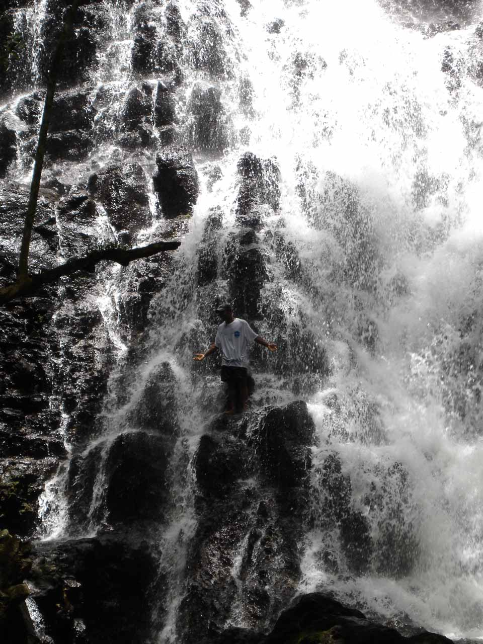 Our guide standing within the falls