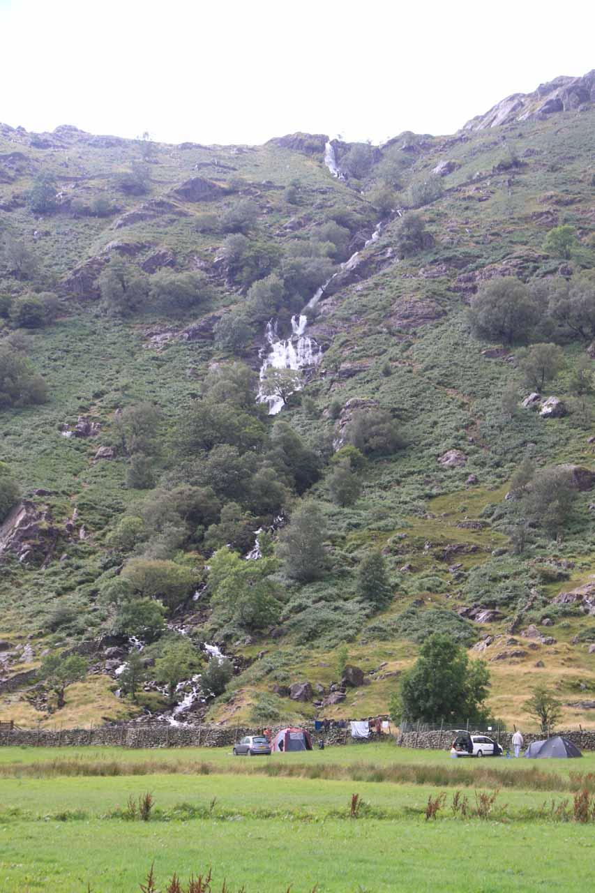 View of the entirety of the Taylor Gill Force with campers below for scale