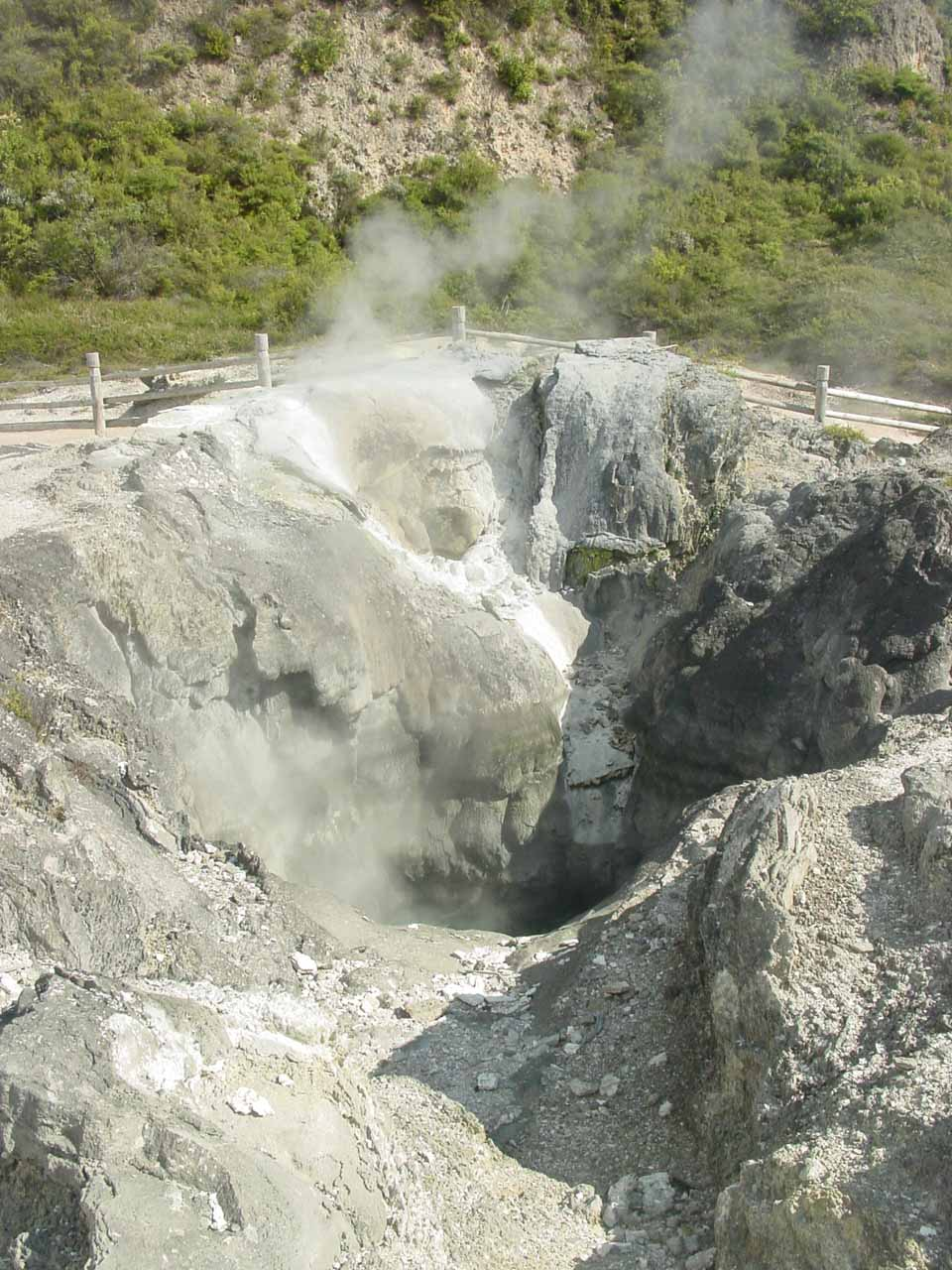 Looking towards some kind of crater formation with steam coming out