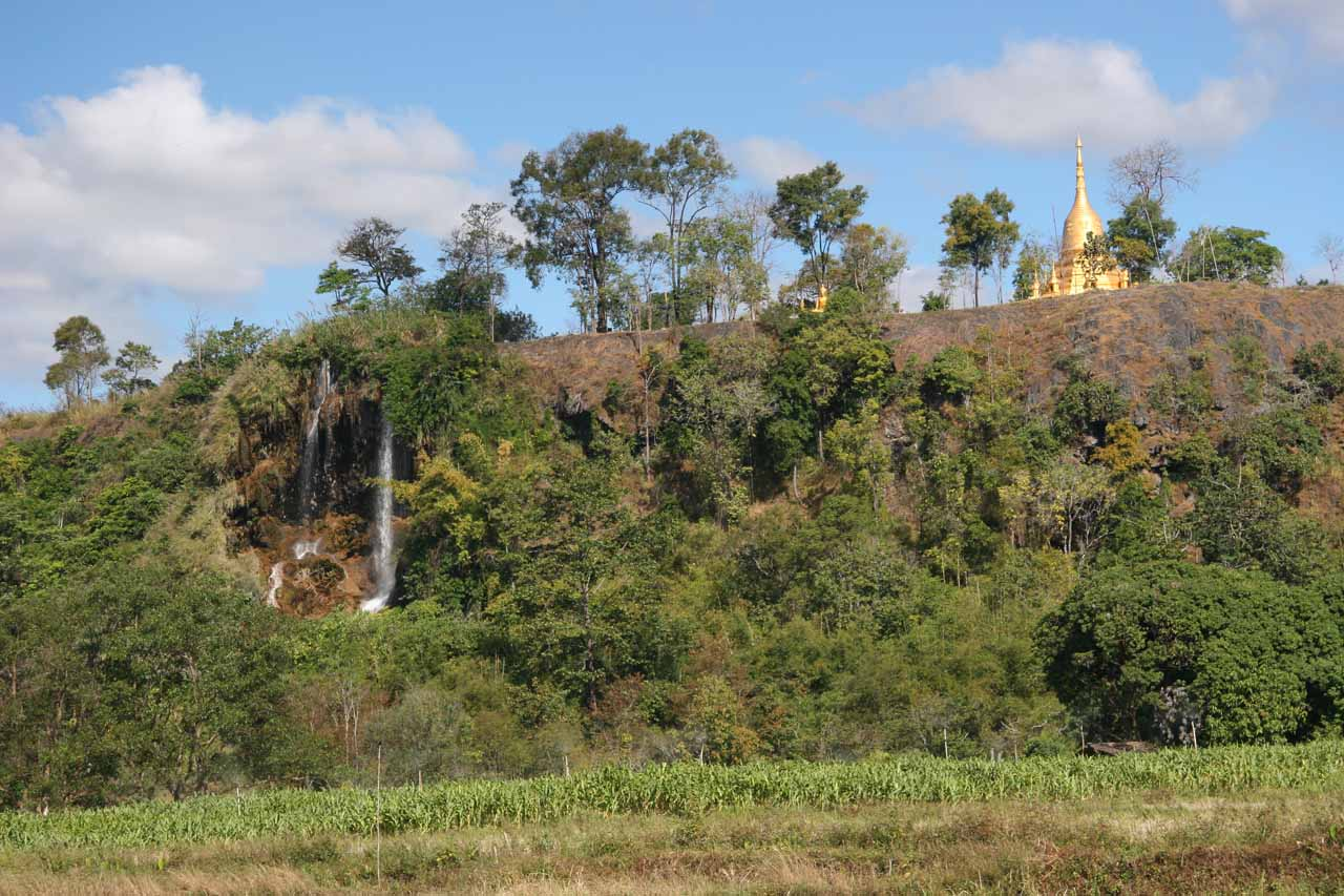 View of chedi and waterfall but from too far along the incorrect road