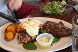 The_29_Palms_Inn_004_05182019 - Julie's surf and turf of the grass-fed flatiron steak along with lobster tail served up at the 29 Palms Inn, which turned out to be a pretty good value considering what we were getting