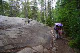 The_Grottos_031_07252020 - Tahia and Julie walking by some glacial erratics just as the rain was starting to fall on the Grottos Trail