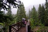 The_Grottos_124_07252020 - Tahia and Julie finally making it back to the main footbridge over the Roaring Fork just as we were getting quite cold and wet from being caught in the rain at the Grottos