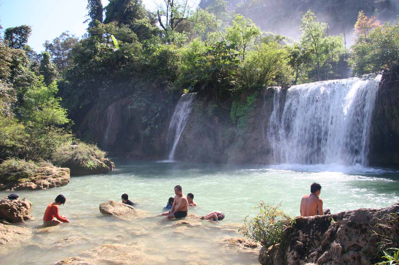 Many holiday-makers enjoying one of Thi Lo Su Waterfall's many swimming holes