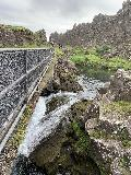 Thingvellir_016_iPhone_08062021 - Looking across the brink of the cascade leading down beneath the bridge as we made our way to the Logberg at Thingvellir