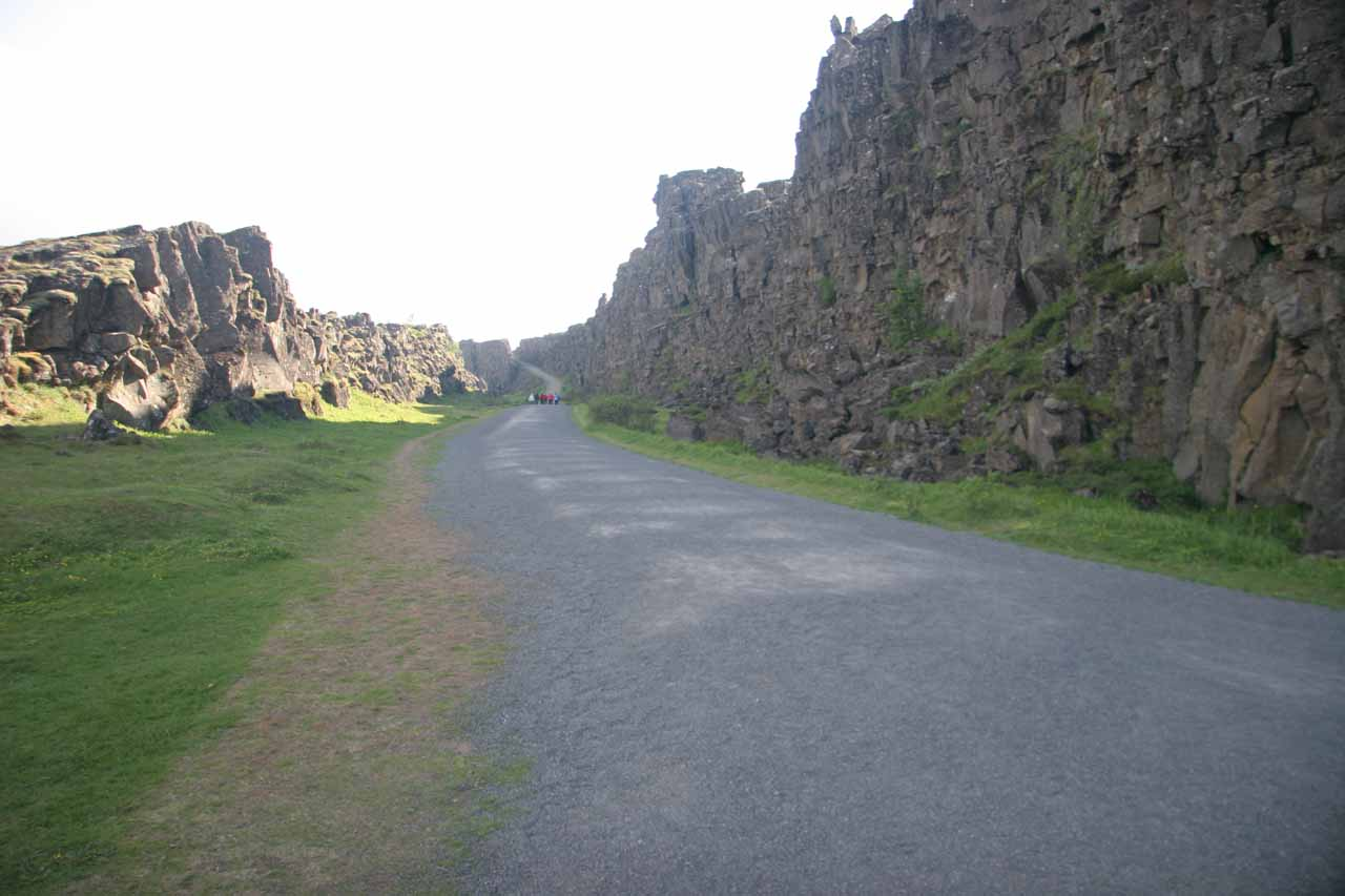 Walking further within the fault while surrounded by volcanic cliffs