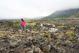 Thjofafoss_003_08202021 - Mom scrambling on the lava field past these directional signs near the Þjófafoss Waterfall