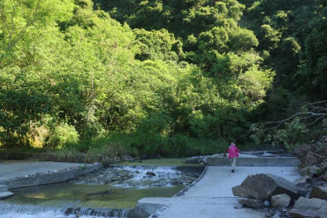 Tiefen_Waterfall_011_10272016 - Mom on the concrete-flanked Xiuguluan River as we went past a rock slide en route to the Tiefen Waterfall