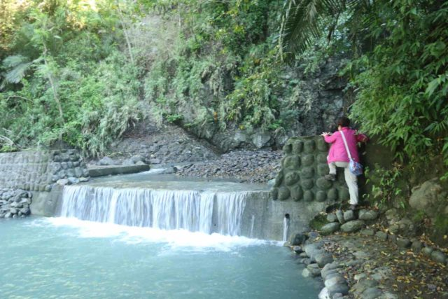Tiefen_Waterfall_058_10272016 - Mom climbing some kind of dam wall in order to get past this obstacle and continue to the Tiefen Waterfall