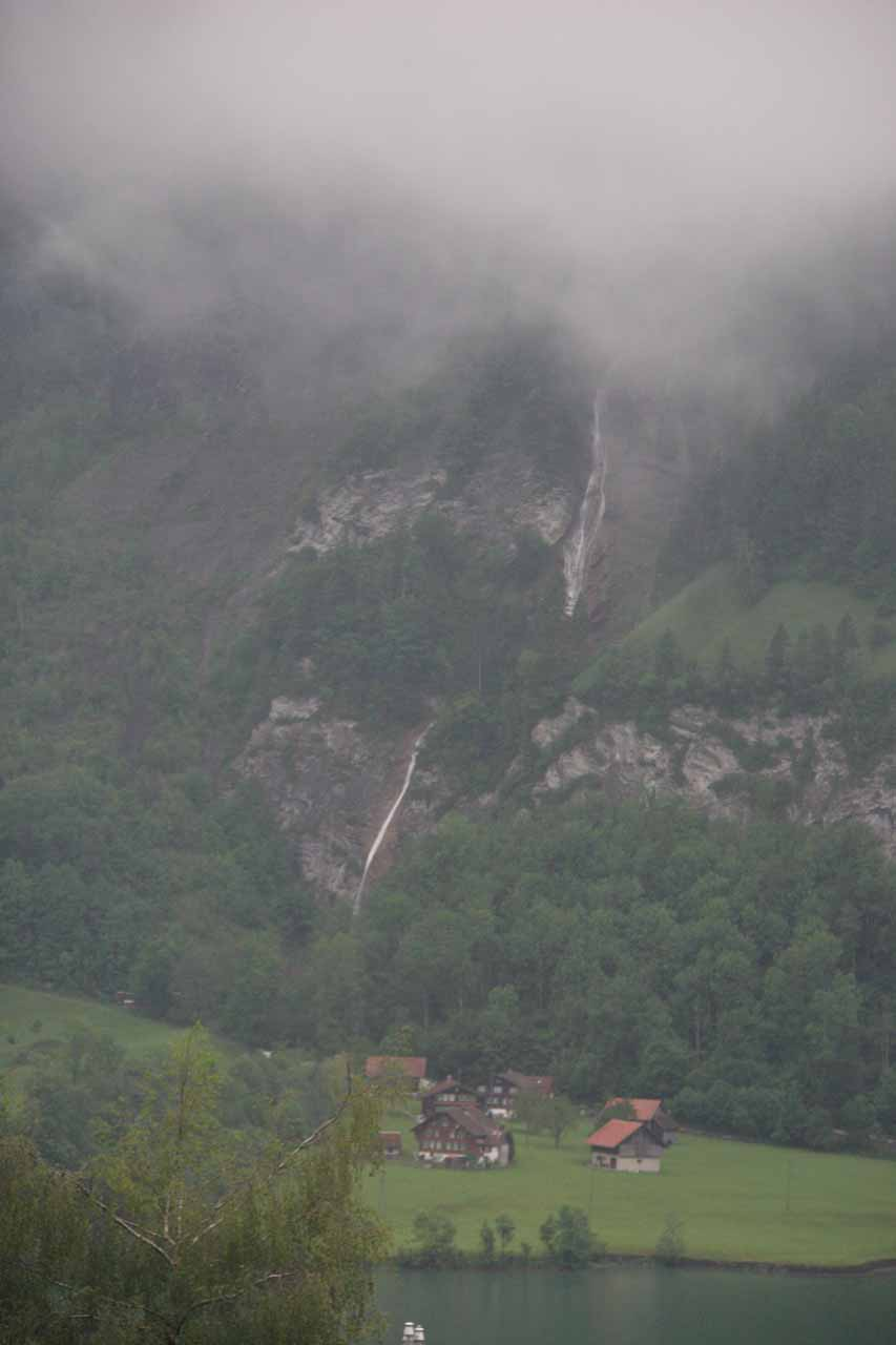 Some cascade revealing itself beneath the clouds on the way to Luzern from Meiringen