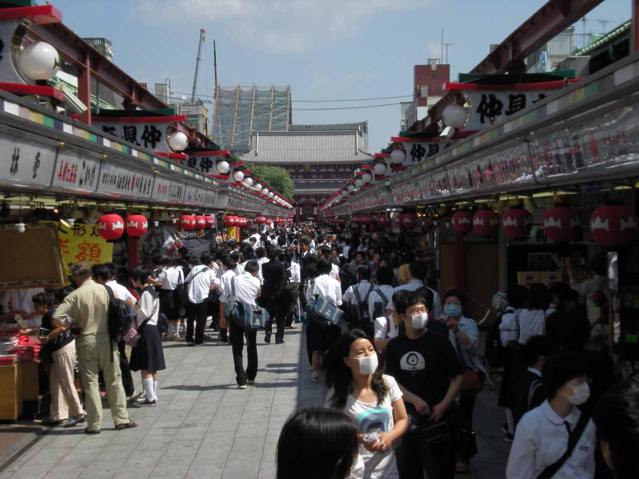 A busy pedestrian area around the Senso-ji Temple