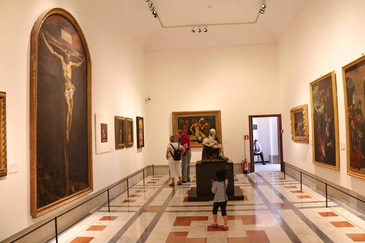 Tahia checking out a particular room with a lot of paintings
