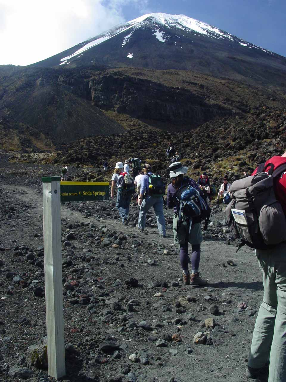 Julie amongst the crowd of people going up amongst the volcanos of Tongariro Crossing