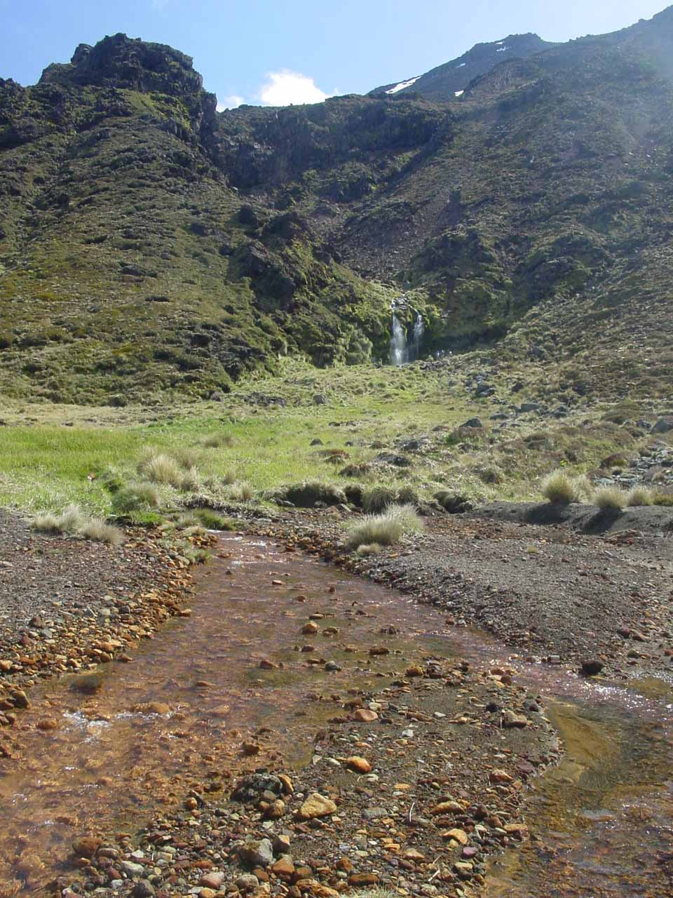 View of Soda Springs from the Tongariro Crossing with a stream passing before it