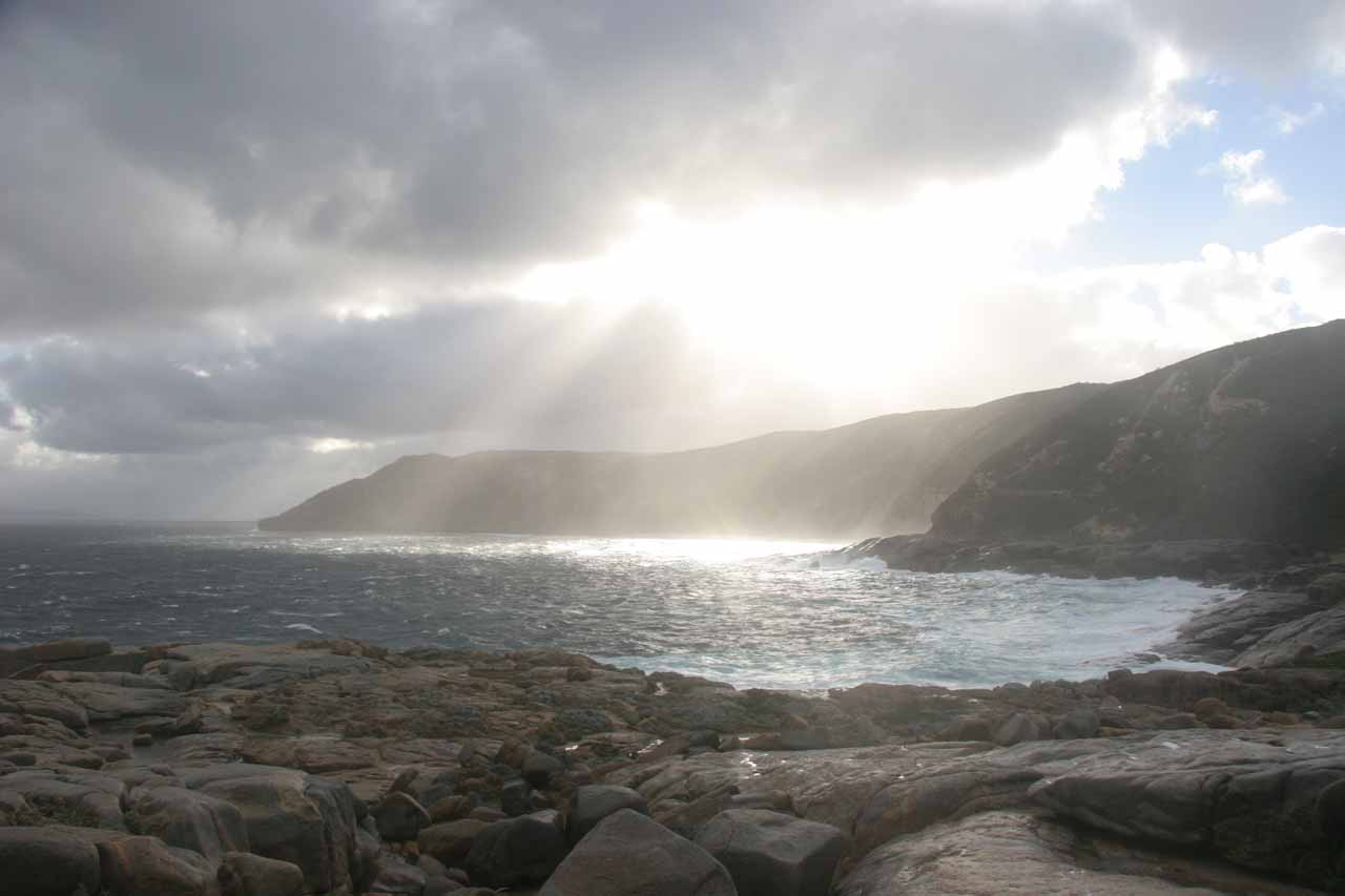 Looking towards the late afternoon sun between some storm clouds at Torndirrup National Park