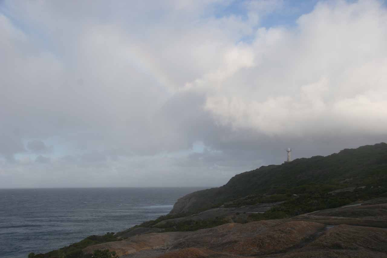 Partial rainbow in the clouds as I was walking closer to the blowhole at Torndirrup