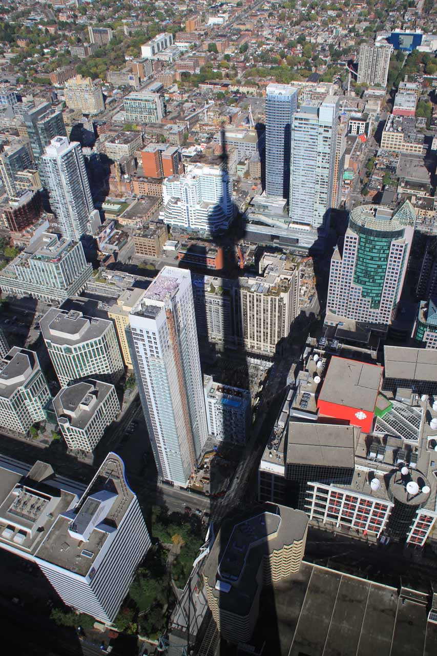 Shadow of the CN Tower still dwarfing the buildings surrounding it