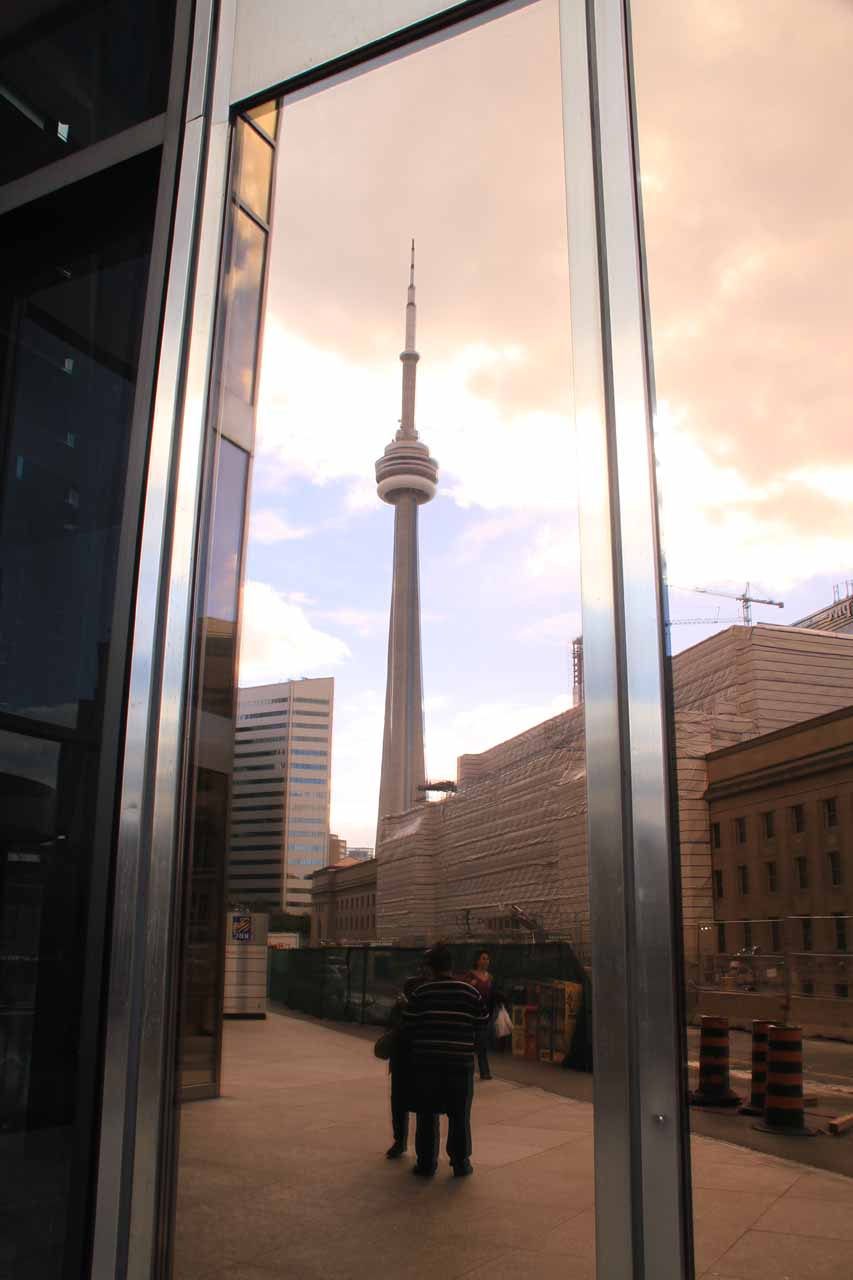 The CN Tower reflected in some business building full of reflective glass