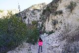 Trail_Canyon_Falls_041_02082020 - Julie and Tahia walking past some old landslides just beyond the last of the homes in Trail Canyon during our February 2020 visit