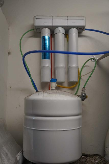 This is the RO system we have at home. Notice the pre-filter, RO membrane, and post-filter sitting above the clean water tank, which goes to show you how much water is required before it reaches the output
