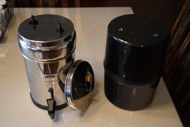 Comparing the Travel Berkey (in its most compact form on the left) with our bear cannister (on the right)