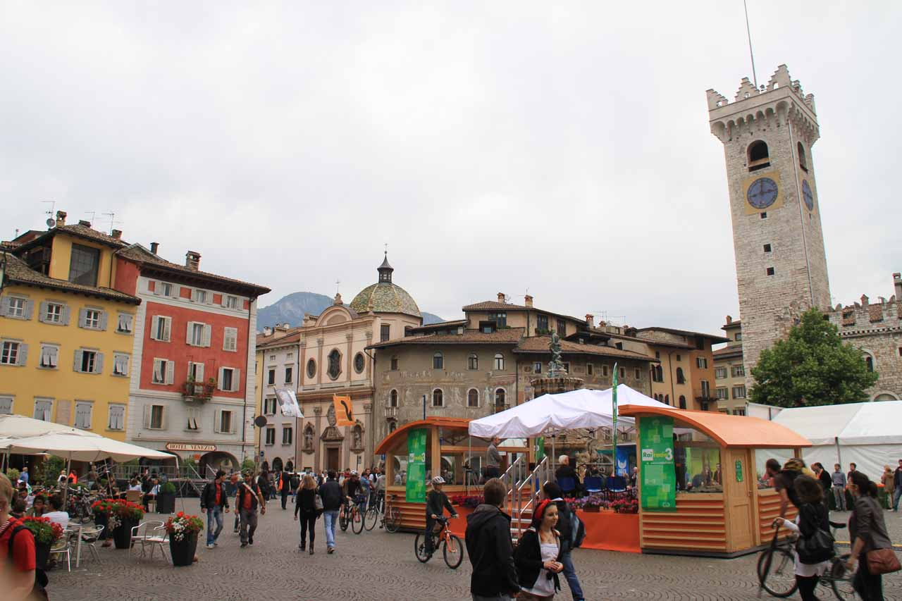 Looking back across the colorful yet happening Piazza del Duomo in Trento