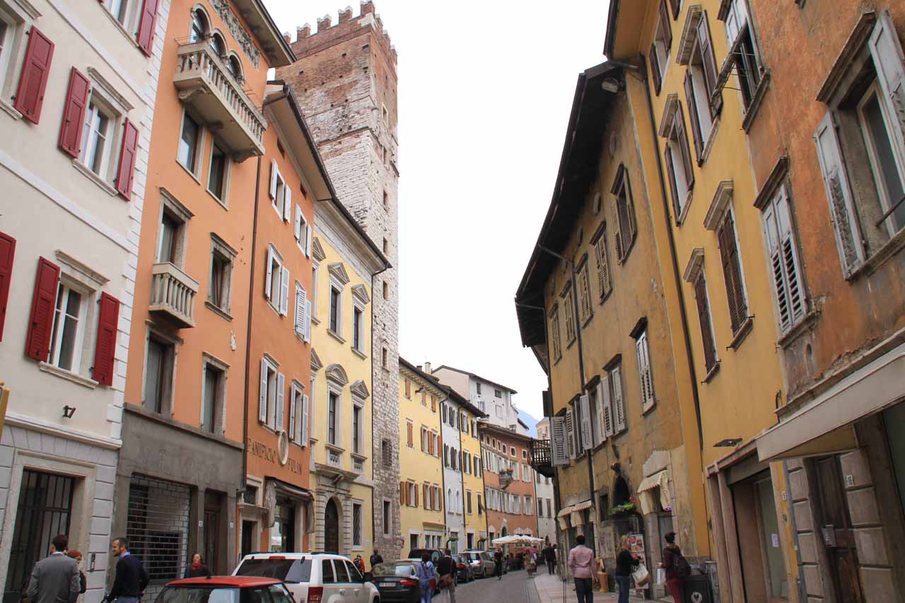 Walking between the colorful buildings comprising the arcades of the Centro Storico of Trento