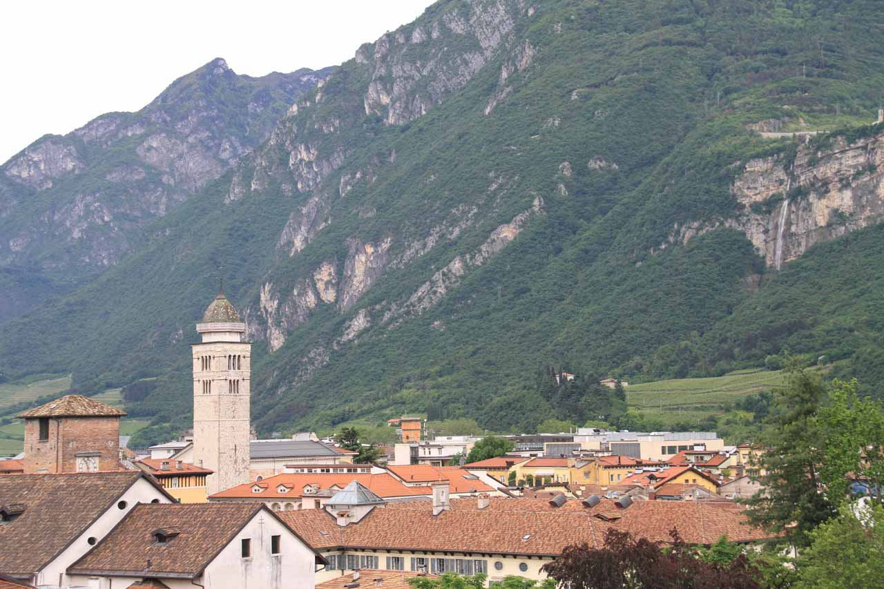 Context of the waterfall with one of the clock towers from the Centro Storico in Trento