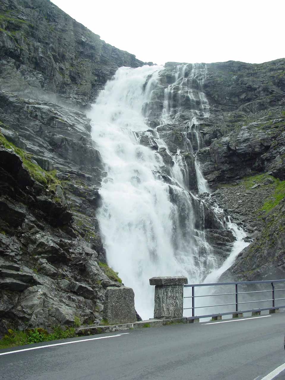 Looking up at the upper sections of Stigfossen from the Trollstigen road next to the bridge Stigfossbrua