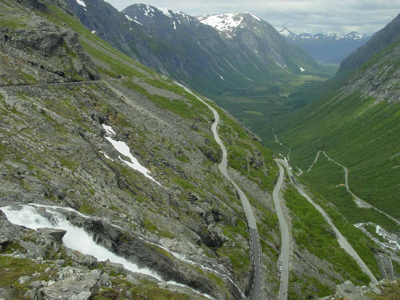 Speaking of Trollstigen, we managed to do the steep and winding serpentine road, and at its top was this view over Stigfossen towards the valley Isterdalen