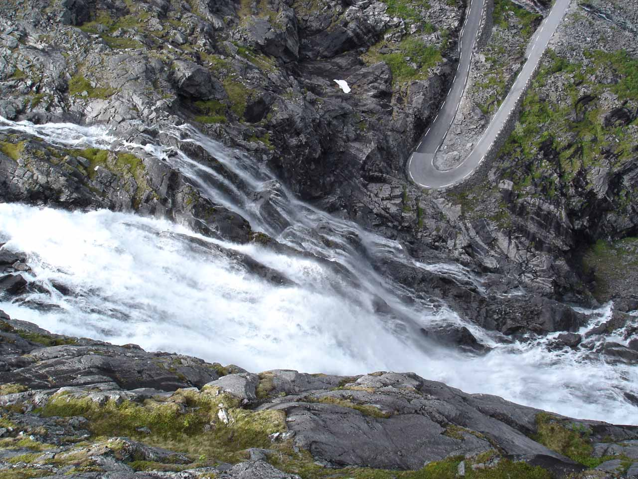 Looking down at part of Stigfossen tumbling besides a switchback