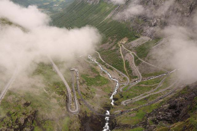 Trollstigen_192_07172019 - If you look towards the center right of this photo between the clouds, you'll notice where Trollstigen had been re-routed as the thinner road (to the left of the main route) was no longer in use