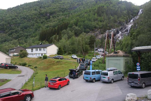 Trolltunga_039_06232019 - Looking down at early birds patiently waiting for the boom gate to the road leading up to Mågelitopp to open up around 6am. This waiting area was at the uphill end of the P2 car park at Skjeggedal