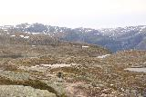 Trolltunga_145_06232019 - Continuing along the moorish plateau dotted with alpine tarns and my first glimpse at part of Ringedalsfossen